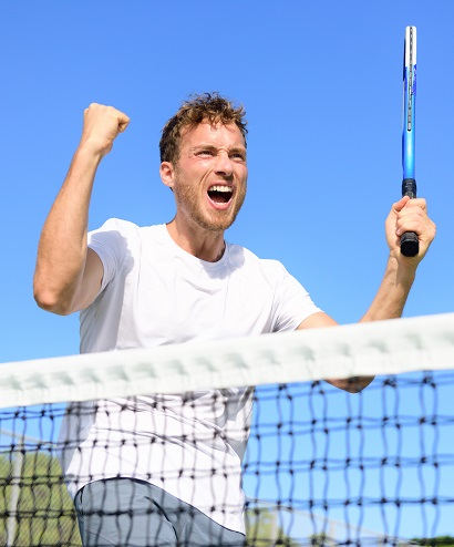 Tennis player celebrating victory. Winning cheering man happy in